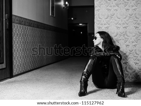 young woman at hotel corridor - stock photo