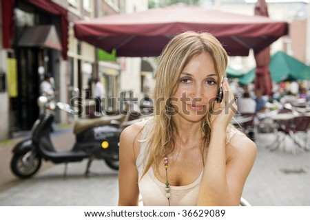 Young woman at outdoor cafe