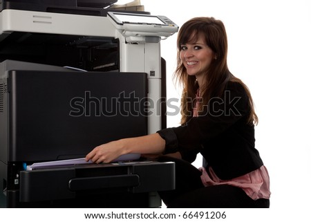 Young woman at the copy machine 9975 - stock photo