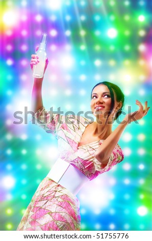 Young woman at the disco. Bright vibrant colors. - stock photo