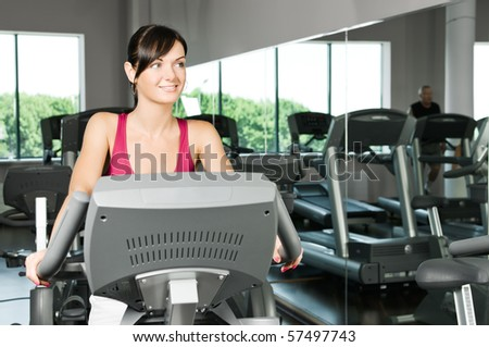 Young woman at the fitness club - stock photo