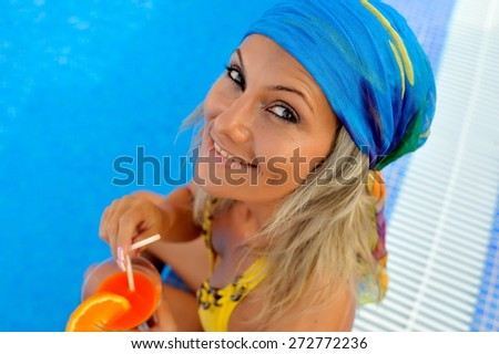 young woman at the pool on a warm summer day - stock photo