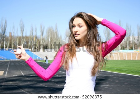 Young woman at the sport competition with stopwatch