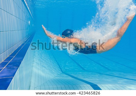 Young woman back dives and makes a loop to come out - stock photo
