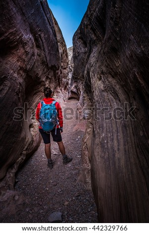 Young Woman Backpacker exploring Little Wild Horse Canyon - stock photo