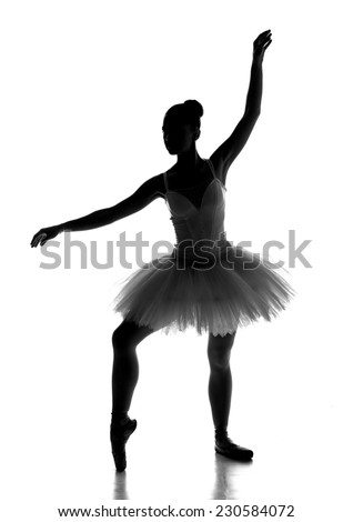 Young woman ballerina is dancing with tutu in silhouette studio on white background. - stock photo