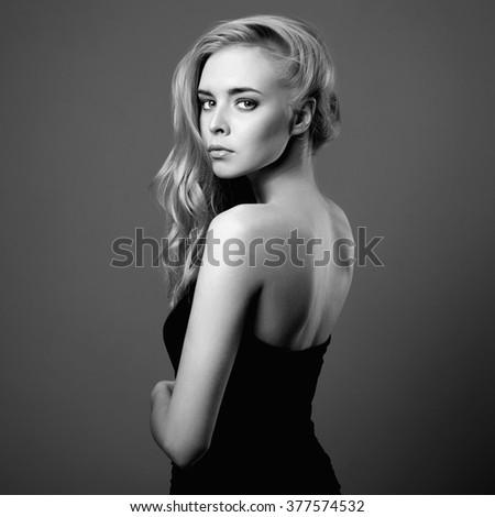 Young woman.Beautiful blonde Girl.close-up fashion monochrome portrait - stock photo