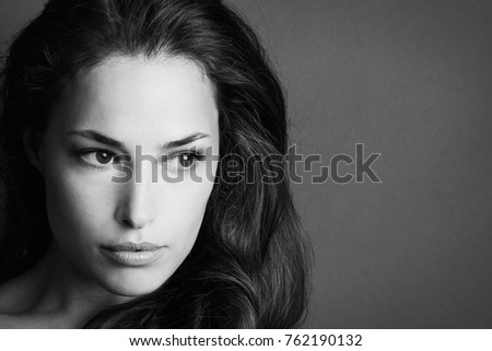 young woman beauty portrait in black and white studio shot