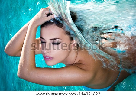 young woman beauty portrait in the water