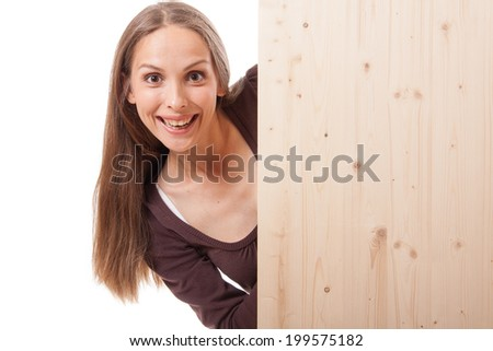 Young woman behind a wooden board - stock photo
