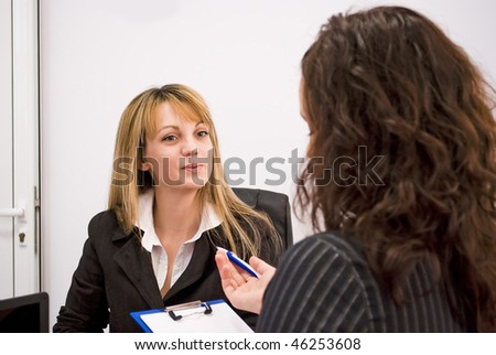 young woman being interviewed for a job - interview feedback - stock photo