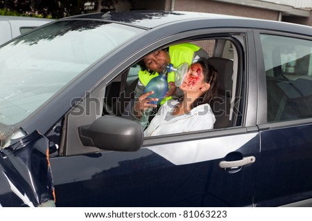 Young woman being resuscitated after a car accident - stock photo