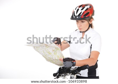 Young woman biker with her bike looking at the map