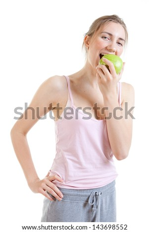 young woman bites apple - stock photo