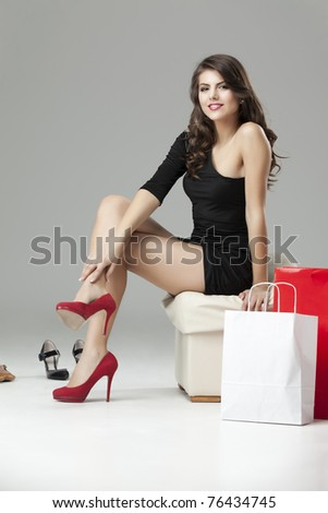 young woman black dress shoe stand high heels - stock photo