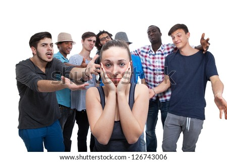 Young Woman Blamed By Her Friends On White Background - stock photo