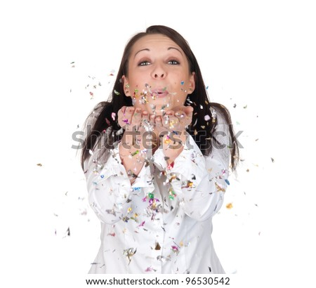 young woman blowing confetti - stock photo