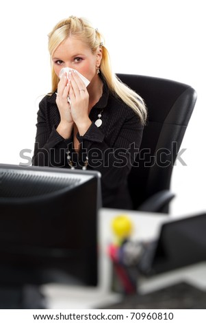 Young woman blowing her nose with tissue at office. Isolated over white background. - stock photo