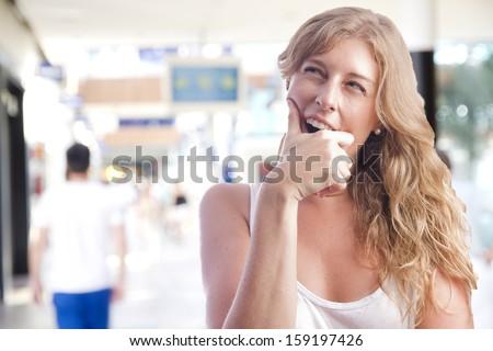 young woman boring in a shopping center - stock photo
