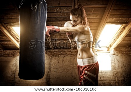 Young woman boxing workout on the attic  - stock photo