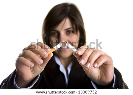 young woman breaking cigar - anti-tobacco concept - stock photo