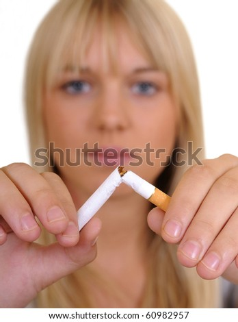 young woman breaks a cigarette