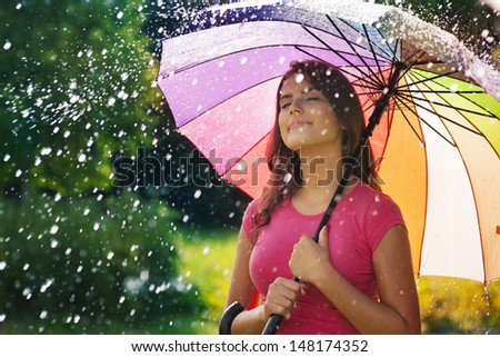 Young woman breathing fresh air during the spring rain  - stock photo