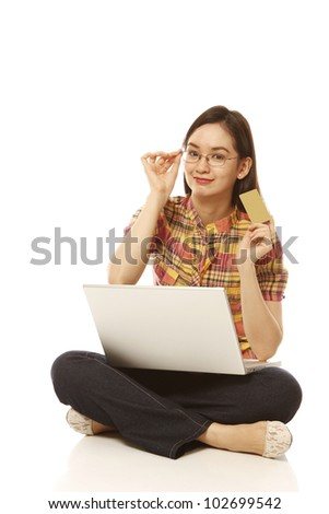 Young woman browsing the internet and shopping online (on white background)