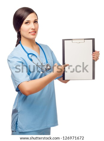 young woman brunette in blue medical suit with stethoscope shows a finger on folder. isolated white background