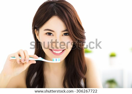 Young woman  brushing teeth in the morning - stock photo