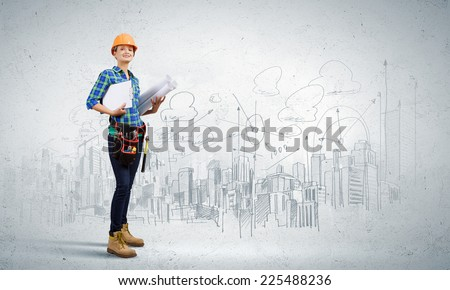 Young woman builder with projects in hand - stock photo