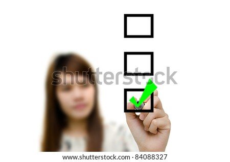 Young woman business hand with pen mark the check boxes.
