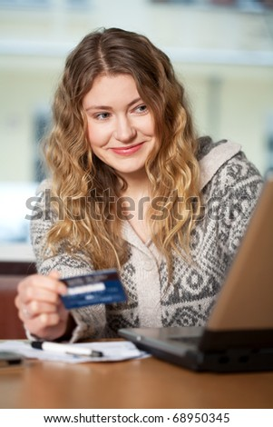 Young woman buys on the web