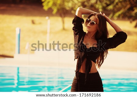 young woman by the pool  enjoy in hot summer day - stock photo