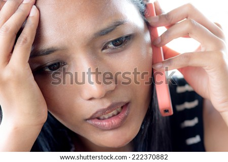 Young woman calling by phone - stock photo