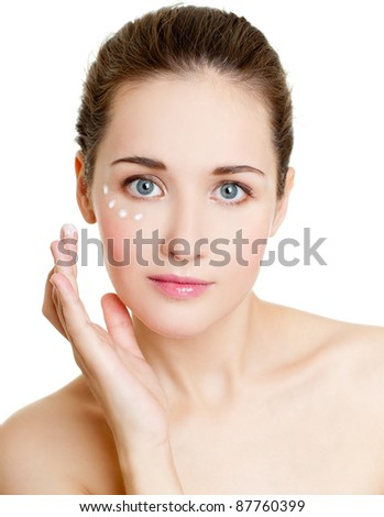young woman cares for face skin