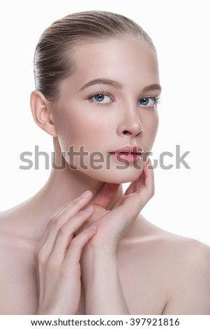 young woman cares for face skin.beautiful girl with clean fresh face. Skin care concept - stock photo