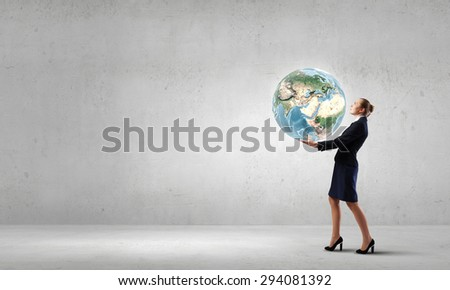 Young woman carrying Earth planet in hands. Elements of this image are furnished by NASA - stock photo