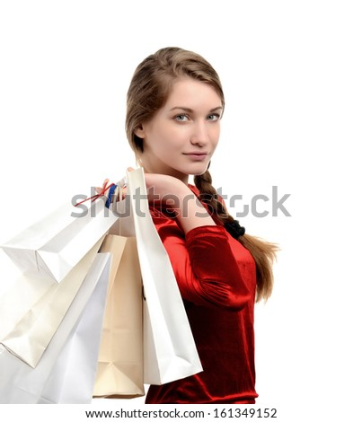 Young woman carrying many shopping bags. Girl shopping isolated on white. - stock photo