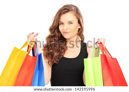 Young woman carrying shopping bags, isolated on white - stock photo