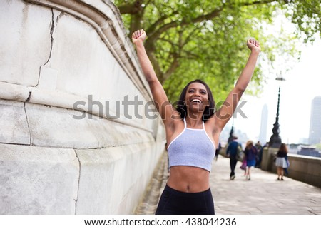 young woman celebrating a fitness goal - stock photo