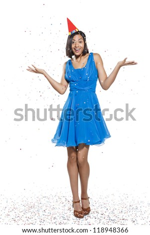 young woman celebrating on white background - stock photo