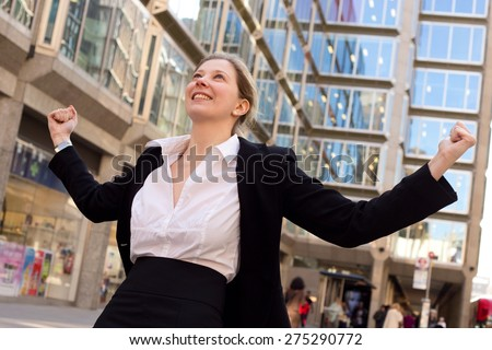 young woman celebrating outdoors - stock photo