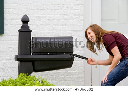 Young Woman Checking for Mail - stock photo