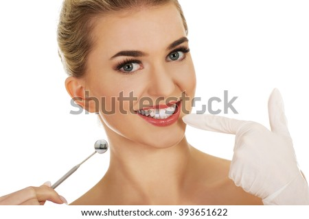 Young woman checking her teeth - stock photo