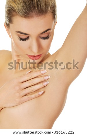 Young woman checks her breast.  Breast cancer concept - stock photo