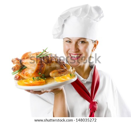 Young woman chef holding a plate with chicken isolated on white - stock photo