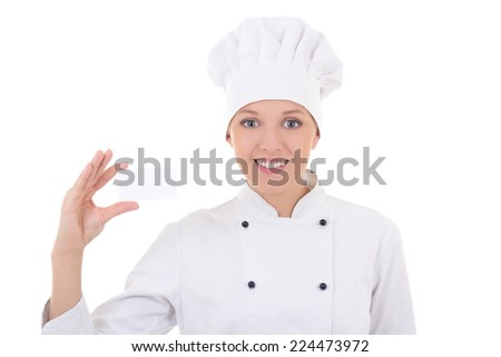 young woman chef  in uniform showing visiting card isolated on white background - stock photo