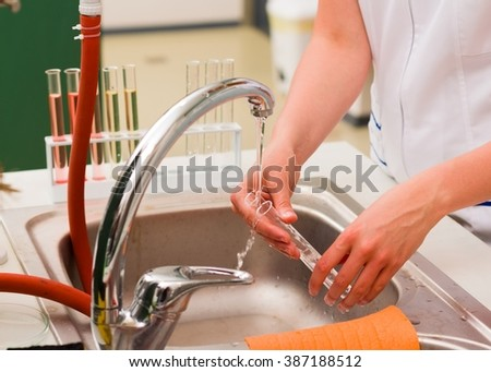 Young woman cleaning after research