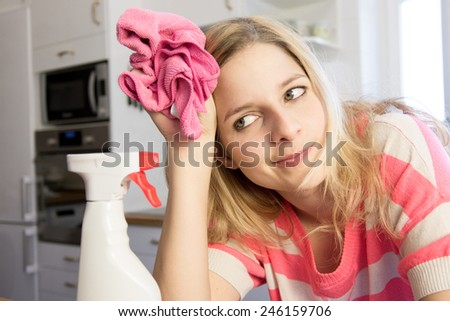 Young woman Cleaning Kitchen Cabinets - stock photo
